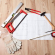 Carpenter tools and building plan — Stock Photo
