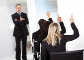 Business at the lecture asking questions — Stock Photo
