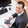 Постер, плакат: Accountant working at the office