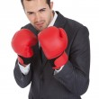 Competitive businessman in boxing gloves — Stock Photo