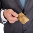 Successful businessman holding credit card — Stock Photo