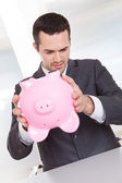 Businessman holding piggybank — Stock Photo