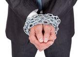 Businessman hands bound in chains — Stock Photo