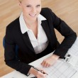 Stock Photo: Cheerful accountant businesswoman