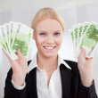 Businesswoman holding euro currency notes — Stock Photo #12409046