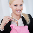 Businesswoman holding euro currency — Stock Photo #12409055