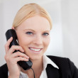 Beautiful businesswomen talking on the phone — Stock Photo