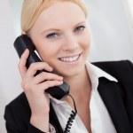 Beautiful businesswomen talking on the phone — Stock Photo