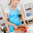 Cheerful young woman cooking — Stockfoto