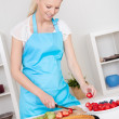 Beautiful young woman making cake - Stock Photo