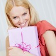 Beautiful young woman with her present — Stock Photo #12409241