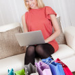 Beautiful young woman buying clothes - Stock Photo
