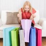 Beautiful young woman checking the shopping bags — Stock Photo