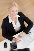 Cheerful accountant businesswoman — Stock Photo