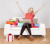 Beautiful young woman buying presents — Stock Photo