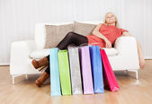 Beautiful young woman relaxing after shopping — Stock Photo