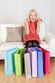 Young woman checking the shopping bags — Stock Photo