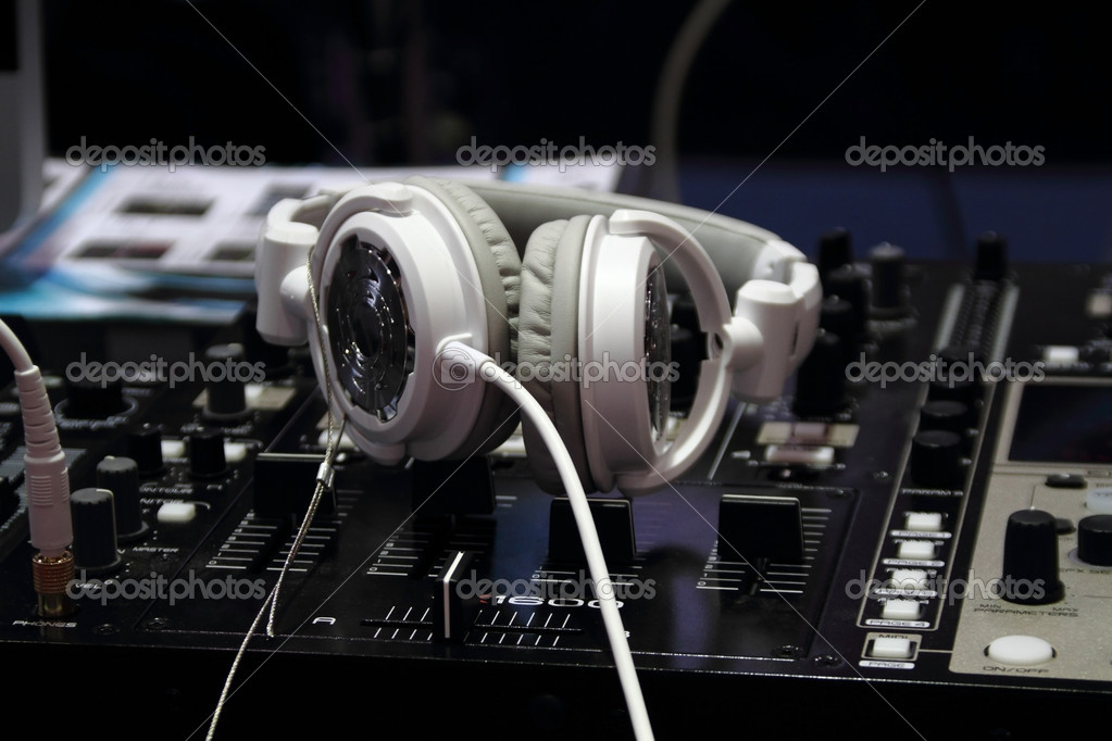 A  white headphones on a professional audio mixer — Stock Photo #10875126