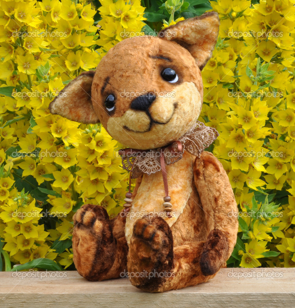 Ron fox cub on a board among flowers. Handmade, the sewed plush toy — Stock Photo #11090082