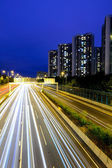 Traffic with blur light through city at night — Stock Photo