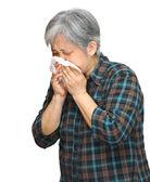 Sneezing mature asian woman — Stock Photo
