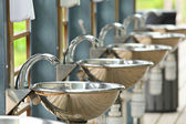 Sinks and taps outdoor — Stock Photo