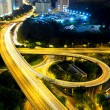 Highway at night in modern city — Stock Photo #12235527