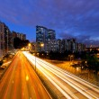 Stock Photo: City in night with busy traffic