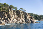 Spain. Lloret de Mar. The rocky coast. — Stock Photo
