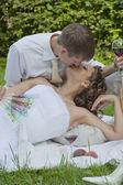 Kiss of married pair on a grass — Foto de Stock