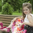 Child on a bench in park — Stock Photo #11776232