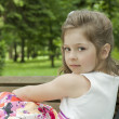 Child on a bench in park — Stock Photo