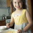 Girl kneads dough — Stock Photo #11971933
