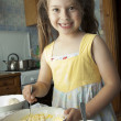 Stock Photo: Girl kneads dough