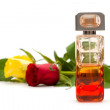 Stock Photo: Perfume and flowers