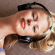 Pretty young woman listening music - Stok fotoraf