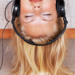 Young woman listening to peaceful music with headphones - Stok fotoraf