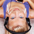 Young woman listening to music - Stok fotoğraf