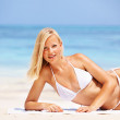 Sexy woman smiling at beach - Stock Photo