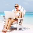 Royalty-Free Stock Photo: Woman in shades with laptop