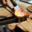 Melting with a blowtorch - Stockfoto
