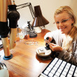 Pretty jeweller smiling at work - Stock Photo