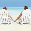 Royalty-Free Stock Photo: Loving couple relaxing on deck chairs