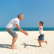 Royalty-Free Stock Photo: Daughter running into her fathers arms at the beach