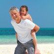 Happy father and daughter having fun on the beach - Stock Photo