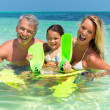 Royalty-Free Stock Photo: Smiling family having fun in sea water
