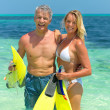 Royalty-Free Stock Photo: Happy couple with snorkeling gear at the beach