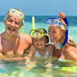 Royalty-Free Stock Photo: Happy family in ocean water ready to snorkel