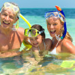 Royalty-Free Stock Photo: Happy family with snorkels having fun