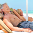 Royalty-Free Stock Photo: Mature couple relaxing on deck chair at summer vacation
